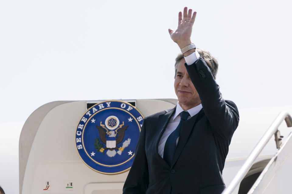 Secretary of State Antony Blinken waves as he boards his plane upon departure from Cairo International Airport, Wednesday, May 26, 2021, in Cairo, Egypt. (AP Photo/Alex Brandon, Pool)