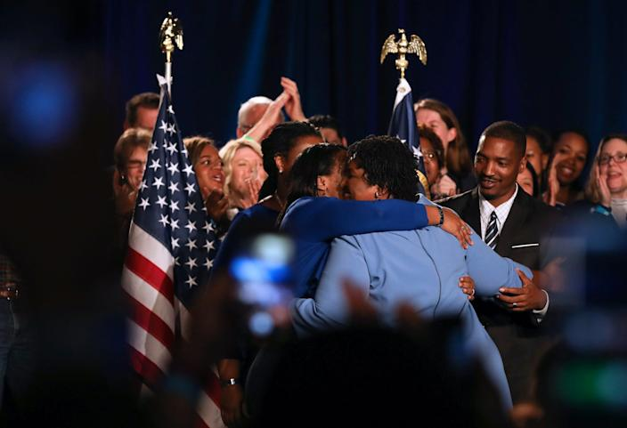 Stacey Abrams embraces her family as she walks off the stage after speaking to the crowd of supporters in 2018.