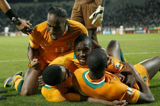 Ivory Coast's Didier Drogba, left, celebrates with his teammates after scoring a goal in a World Cup 2014 qualifying match between Ivory Coast and Senegal at Mohammed V stadium in Casablanca, Morocco, Saturday Nov. 16, 2013. Ivory Coast qualified for the World Cup tournament by beating Senegal 4-2 on aggregate in a playoff for next year's finals in Brazil after a 1-1 draw. (AP Photo/Abdeljalil Bounhar)