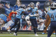 Tennessee Titans safety Amani Hooker (37) celebrates with Chris Jackson (35) after Hooker intercepted a pass in the end zone in the second half of an NFL football game against the Pittsburgh Steelers Sunday, Oct. 25, 2020, in Nashville, Tenn. (AP Photo/Wade Payne)