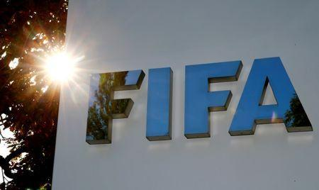 FILE PHOTO: The logo of FIFA is seen in front of its headquarters in Zurich, Switzerland September 26, 2017. REUTERS/Arnd Wiegmann