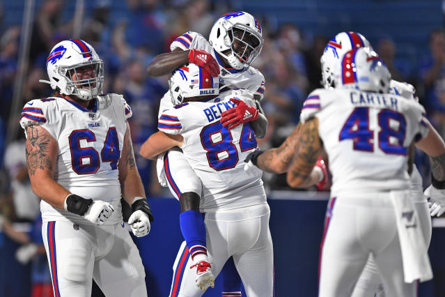 Buffalo Bills' Christian Wade, top, celebrates his touchdown with teammates during the second half of an NFL preseason football game against the Indianapolis Colts, Thursday, Aug. 8, 2019, in Orchard Park, N.Y. (AP Photo/Adrian Kraus)