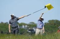 Wyndham Clark points to the direction of an errant tee shot on the eighth hole during the first round of the PGA Championship golf tournament on the Ocean Course Thursday, May 20, 2021, in Kiawah Island, S.C. (AP Photo/Matt York)