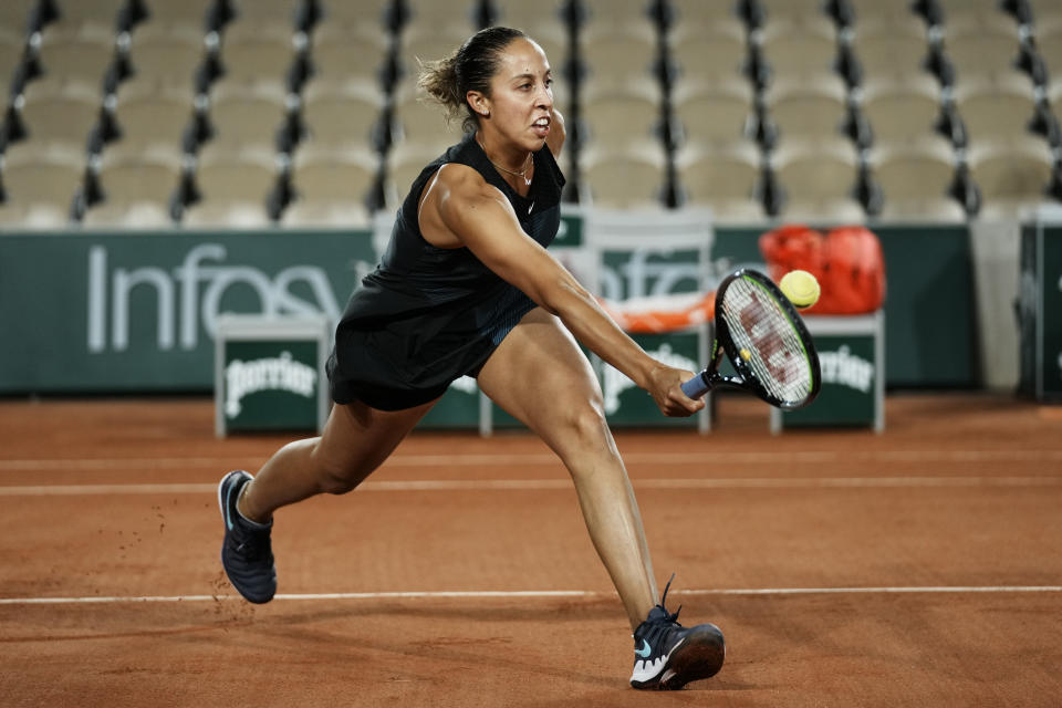 United States' Madison Keys returns the ball to Oceane Dodin of France during their first round match of the French Open tennis tournament at the Roland Garros stadium Sunday, May 30, 2021 in Paris. (AP Photo/Thibault Camus)