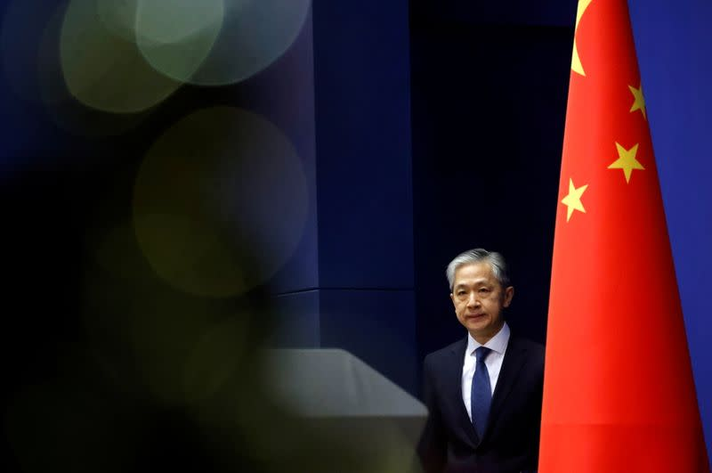 Chinese Foreign Ministry spokesman Wang Wenbin attends a news conference in Beijing