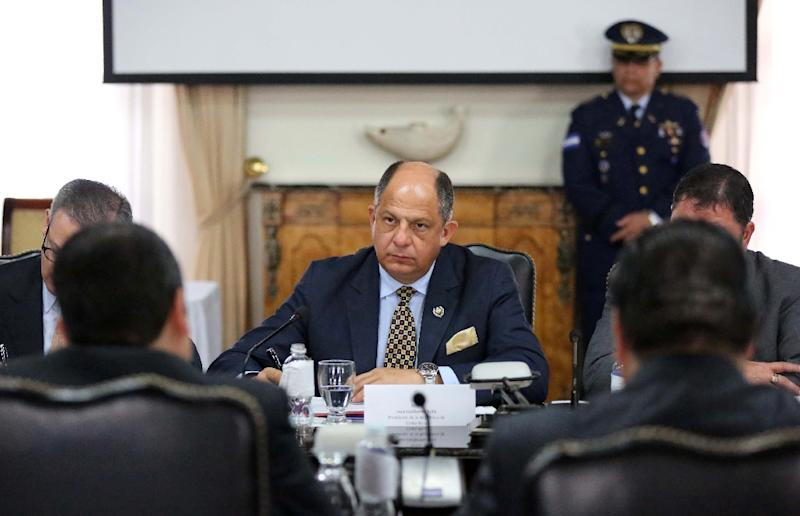 "The government of Costa Rican President Luis Guillermo Solis (C), pictured on December 17, 2015, called December 21 for ""concrete and effective actions"" demonstrating a desire for rapprochement on the part of neighboring Nicaragua (AFP Photo/)"