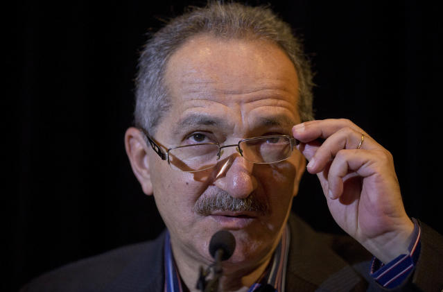 Brazil's Sports Minister Aldo Rebelo adjusts his glasses during a news conference in Sao Paulo, Brazil, Monday, Oct. 28, 2013. Rebelo is not expecting waves of protests during the World Cup next year, saying the Brazilian people will be more worried about celebrating the tournament than complaining of its cost. (AP Photo/Andre Penner)