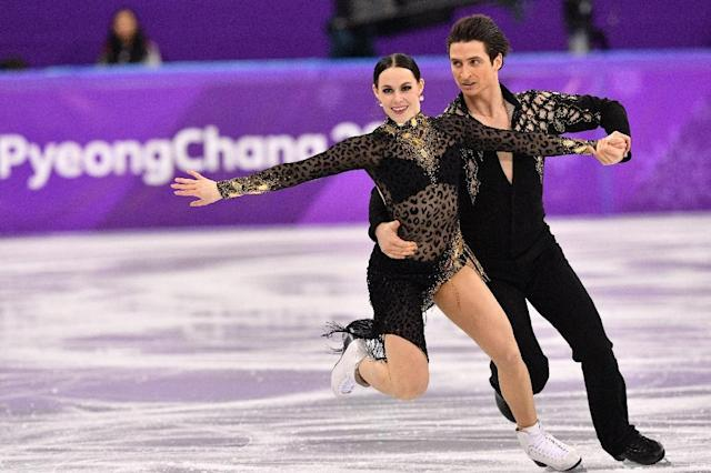 Canada's Tessa Virtue and Scott Moir set a world record in ice dance figure skating after the short dance at the Pyeongchang 2018 Winter Olympic Games (AFP Photo/Mladen ANTONOV)