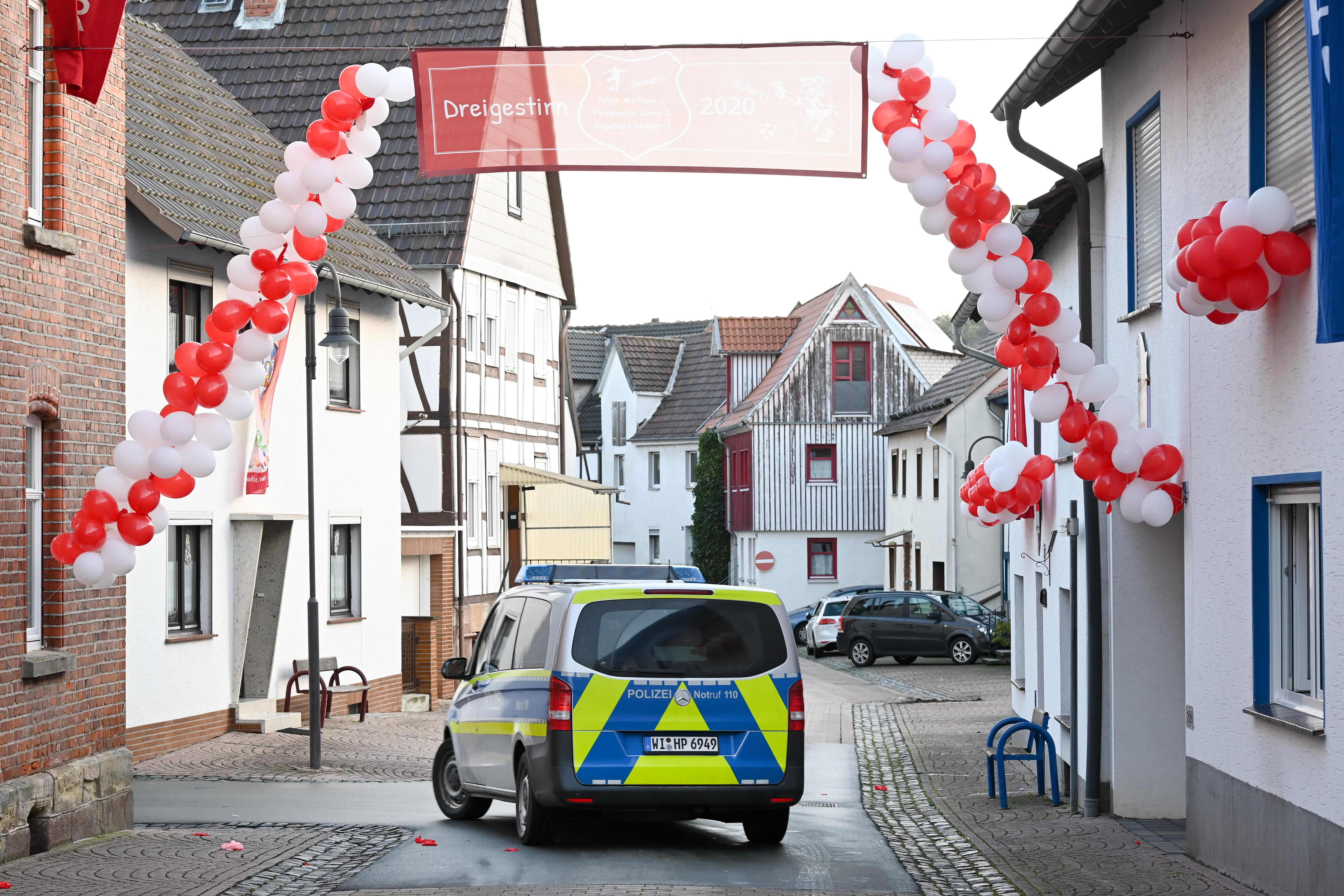 25 February 2020, Hessen, Volkmarsen: A police car passes under a garland of balloons. The day before, a man had driven his car into a carnival parade and injured numerous people, including children. The Frankfurt public prosecutor's office is investigating an attempted homicide. Photo: Uwe Zucchi/dpa (Photo by Uwe Zucchi/picture alliance via Getty Images)