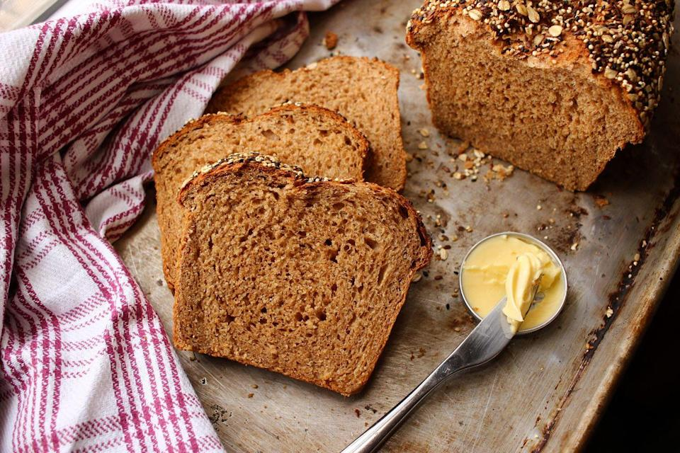 """<p>Unlike white bread, whole-wheat bread is made from flour that uses almost the entire wheat grain—with the bran and germ in tact. This means more nutrients and fiber per slice! This bread is also great for sandwiches or, my personal favorite, <a href=""""https://www.delish.com/cooking/recipe-ideas/recipes/a50946/avocado-egg-in-a-hole-recipe/"""" rel=""""nofollow noopener"""" target=""""_blank"""" data-ylk=""""slk:egg in a hole"""" class=""""link rapid-noclick-resp"""">egg in a hole</a>. </p><p>Try it in <a href=""""https://www.delish.com/cooking/videos/a45499/avocado-toast-cheat-sheet/"""" rel=""""nofollow noopener"""" target=""""_blank"""" data-ylk=""""slk:Avocado Toast 6 Ways"""" class=""""link rapid-noclick-resp"""">Avocado Toast 6 Ways</a> from Delish.</p>"""