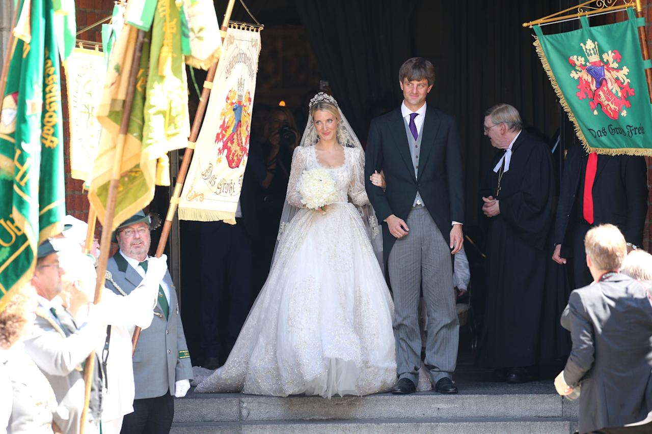 """The lace-topped <a rel=""""nofollow"""" href=""""https://www.glamour.com/about/wedding-dresses?mbid=synd_yahoo_rss"""">wedding dress</a> that fashion designer Ekaterina Malysheva wore for her 2017 wedding to Prince Ernst August Jr. (stepson of Princess Caroline of Monaco and son of Ernst August, Prince of Hanover) had a neckline that dipped considerably lower. Designed by Sandra Mansour, a friend of the bride's, the <a rel=""""nofollow"""" href=""""https://www.glamour.com/about/wedding-gowns?mbid=synd_yahoo_rss"""">gown</a> also featured intricate beadwork that incorporated pearls."""