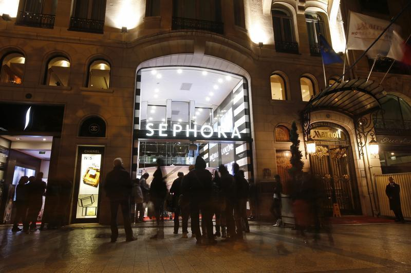 People walk out of the Sephora store on the Champs Elysees Avenue in Paris