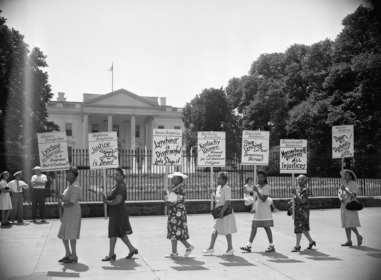 Negro delegates from several states parade with signs in front of the White House to protest the mob slaying of four negroes in Georgia recently in Washington, D.C circa 1954. The picketers were mostly women and they carried on their demonstration in an orderly manner, letting their signs tell their story.