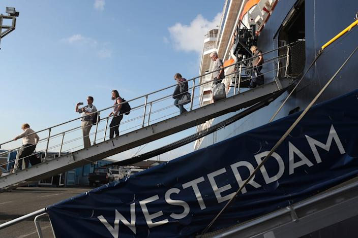 Passengers of the MS Westerdam disembarking at the port of Sihanoukville, Cambodia, on Saturday.