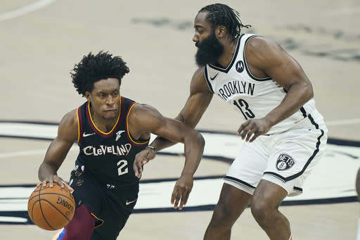 Cleveland Cavaliers' Collin Sexton (2) drives past Brooklyn Nets' James Harden (13) during the first half of an NBA basketball game, Wednesday, Jan. 20, 2021, in Cleveland. (AP Photo/Tony Dejak)