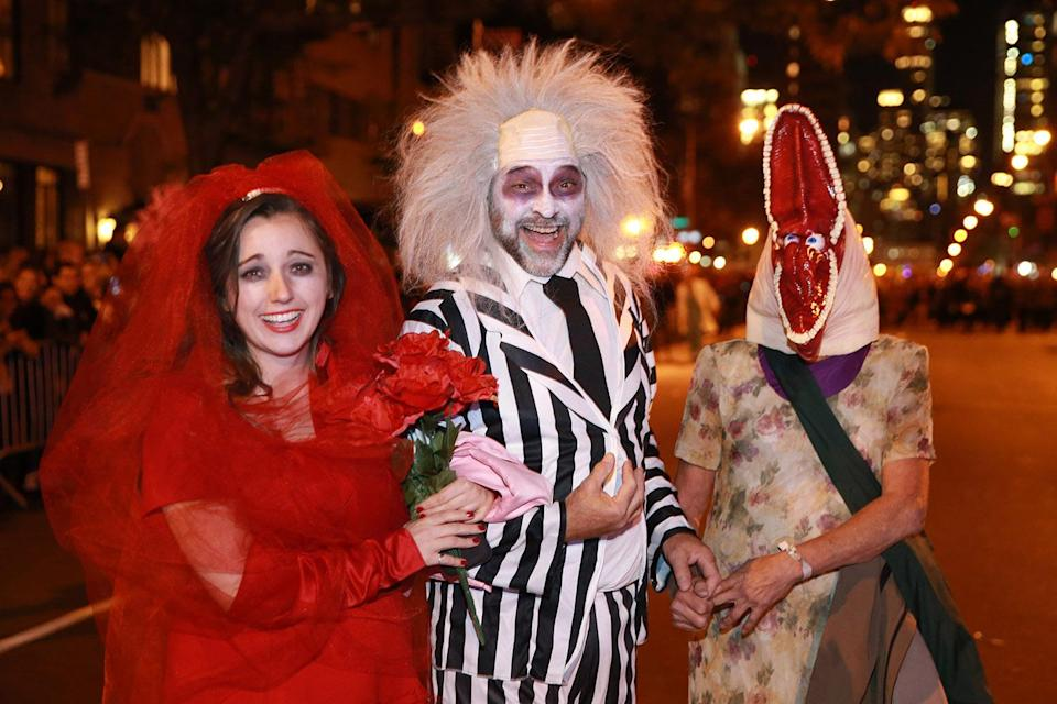 """<p>People wearing costumes from the movie """"Beetlejuice"""" participate in the 44th annual Village Halloween Parade in New York City on Oct. 31, 2017. (Photo: Gordon Donovan/Yahoo News) </p>"""