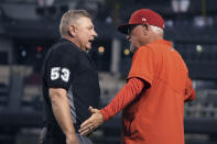 Los Angeles Angels manager Joe Maddon talks to umpire Greg Gibson after Shohei Ohtani was called for his second balk of the night, in the fifth inning of the team's baseball game against the Arizona Diamondbacks, Friday, June 11, 2021, in Phoenix. (AP Photo/Rick Scuteri)