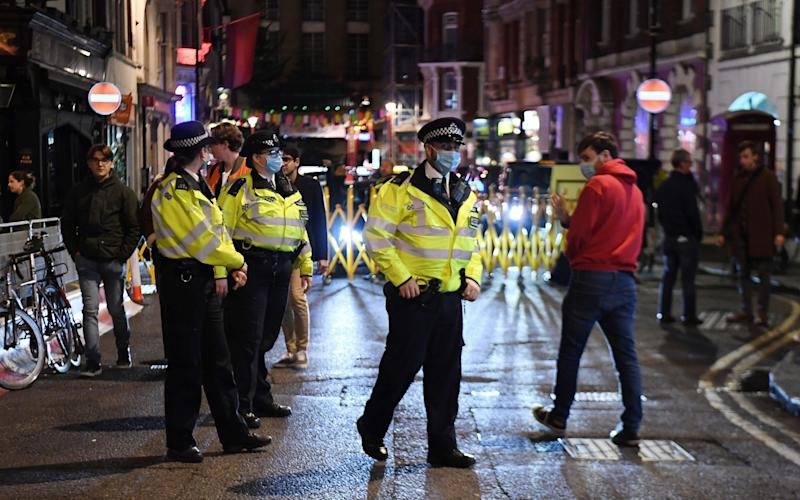 Police patrol, making sure no one finishes their dessert past 10pm - ANDY RAIN/EPA-EFE/Shutterstock