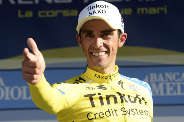 Spain's Alberto Contador celebrates on the podium after winning the fifth stage of the Tirreno Adriatico cycling race from Amatrice to Guardiagrele, Italy, Sunday, March 16, 2014. Alberto Contador again showed his strength in the mountains as he claimed a second successive Tirreno-Adriatico stage win to move into the overall lead on Sunday. Contador, who won the grueling fourth stage of the race on Saturday, recorded a dominant victory over another tough leg from Amatrice to Guardiagrele, finishing in 4 hours, 54 minutes and 42 seconds. (AP Photo/Fabio Ferrari, Lapresse)