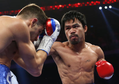 Manny Pacquiao defeats Chris Algieri in November. (AP)