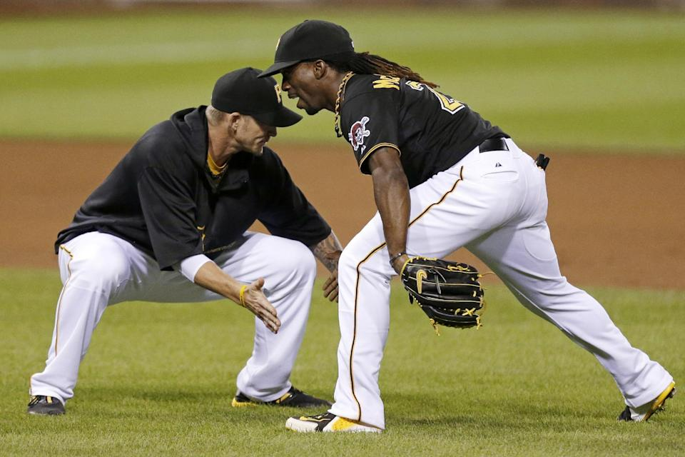 Pittsburgh Pirates center fielder Andrew McCutchen , right, celebrates with A.J. Burnett (34) after the Pirates' 5-4 win over the St. Louis Cardinals in a baseball game in Pittsburgh on Wednesday, July 31, 2013. (AP Photo/Gene J. Puskar)