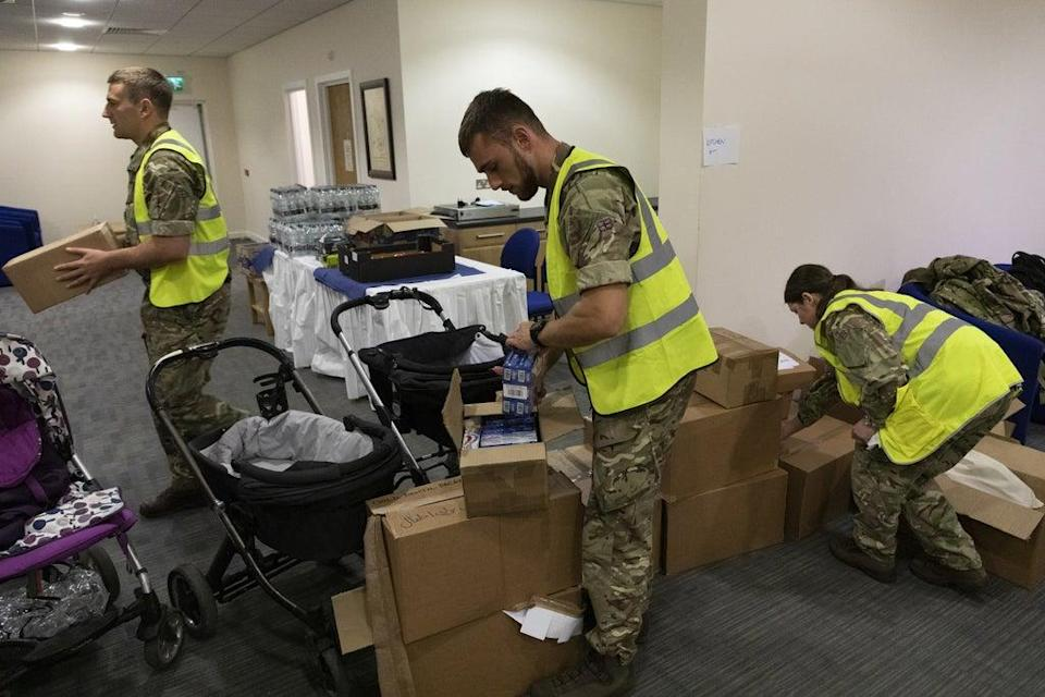 RAF personnel packing necessities for Afghan nationals arriving at RAF Brize Norton (SAC Samantha Holden RAF/PA) (PA Media)