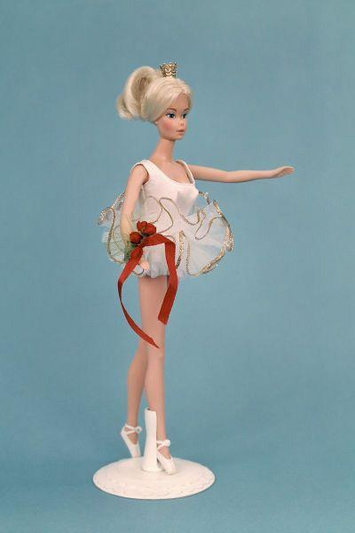 <p>Dressed in a white bodysuit and tutu accented with a red ribbon, Ballerina Barbie became the inspiration for many a ballet class. </p>