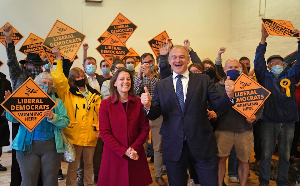 Lib Dem leader Ed Davey and new MP Sarah Green celebrating the result on Friday (PA)