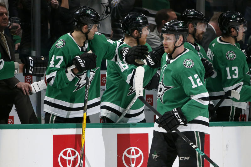 Dallas Stars center Radek Faksa (12) celebrates his goal against the Arizona Coyotes with right wing Alexander Radulov (47) during the second period of an NHL hockey game in Dallas, Wednesday, Feb. 19, 2019. (AP Photo/Michael Ainsworth)