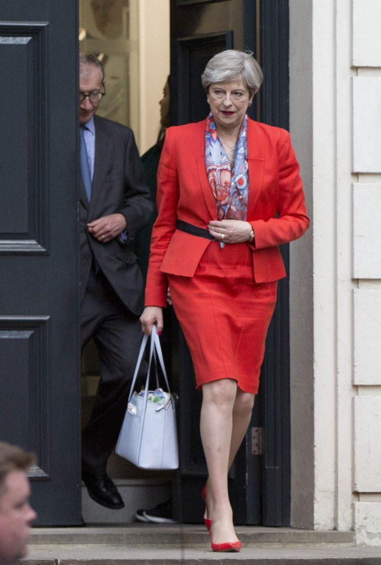 <i>May appeared on election night in matching red shoes and lips [Photo: PA]</i>