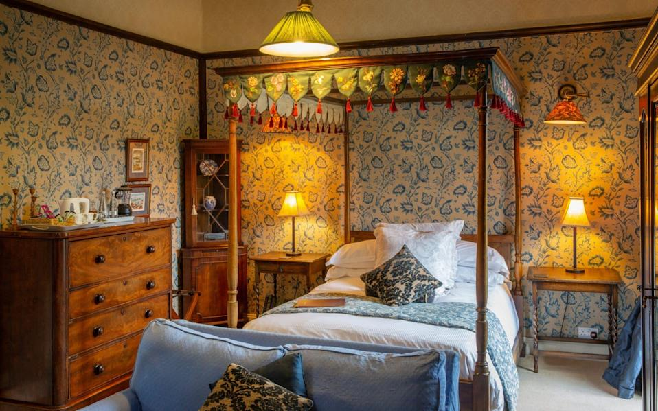 Augill Castle room with four-poster bed