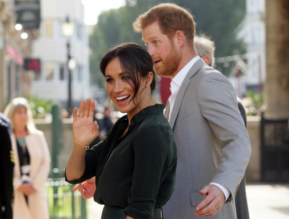 Britain's Prince Harry, Duke of Sussex (R) and Britain's Meghan, Duchess of Sussex (L) arrive to visit the Royal Pavilion in Brighton in East Sussex, southern England, on October 3, 2018. - The Duke and Duchess of Sussex made their first joint official visit to Sussex on October 3. (Photo by Tim IRELAND / POOL / AFP)        (Photo credit should read TIM IRELAND/AFP via Getty Images)