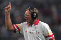 """FILE - In this Sept. 15, 1996, file photo, Kansas City Chiefs coach Marty Schottenheimer yells instructions to his team as they play against the Seattle Seahawks in Seattle. Marty Schottenheimer, who won 200 regular-season games with four NFL teams thanks to his """"Martyball"""" brand of smash-mouth football but regularly fell short in the playoffs, has died. He was 77. Schottenheimer died Monday night, Feb. 8, 2021, at a hospice in Charlotte, North Carolina, his family said through Bob Moore, former Kansas City Chiefs publicist. (AP Photo/Barry Sweet, File)"""