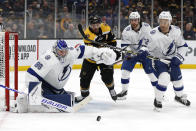 Boston Bruins' David Krejci (46) tries to get through Tampa Bay Lightning's Brayden Point, Kevin Shattenkirk (22) and goaltender Andrei Vasilevskiy (88) to get to the puck during the second period of an NHL hockey game Saturday, March 7, 2020, in Boston. (AP Photo/Winslow Townson)