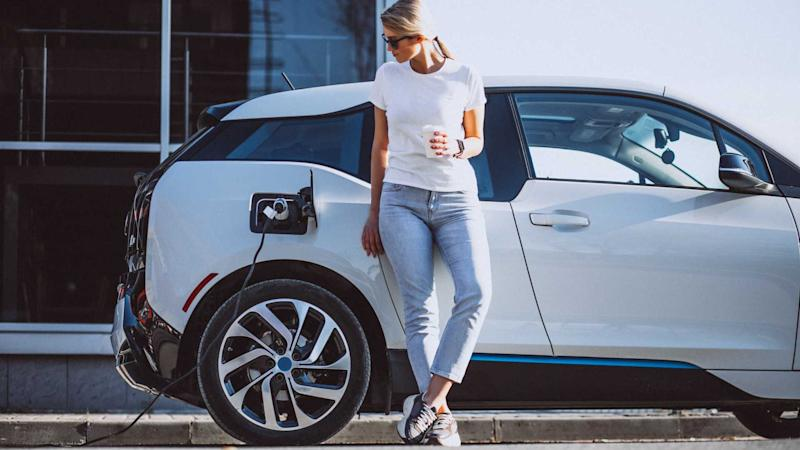 Woman waiting while charging BMW i3