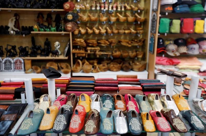 FILE PHOTO: Souvenir items are displayed for sale at an empty shop in Hammamet