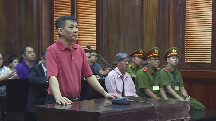 """Michael Nguyen stands during his trial, Monday, June 24, 2019, in Ho Chin Minh City, Vietnam. The American of Vietnamese origin was sentenced to 12 years in prison for """"attempt to overthrow the state."""" (Nguyen Thanh Chung/Vietnam News Agency via AP)"""