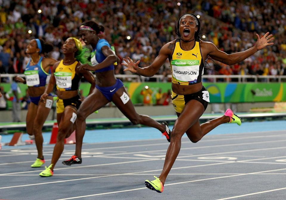<p>Elaine Thompson of Jamaica celebrates winning the Women's 100m Final ahead of Tori Bowie of the United States and Shelly-Ann Fraser-Pryce of Jamaica on Day 8 of the Rio 2016 Olympic Games at the Olympic Stadium on August 13, 2016 in Rio de Janeiro, Brazil. (Photo by Ian Walton/Getty Images) </p>