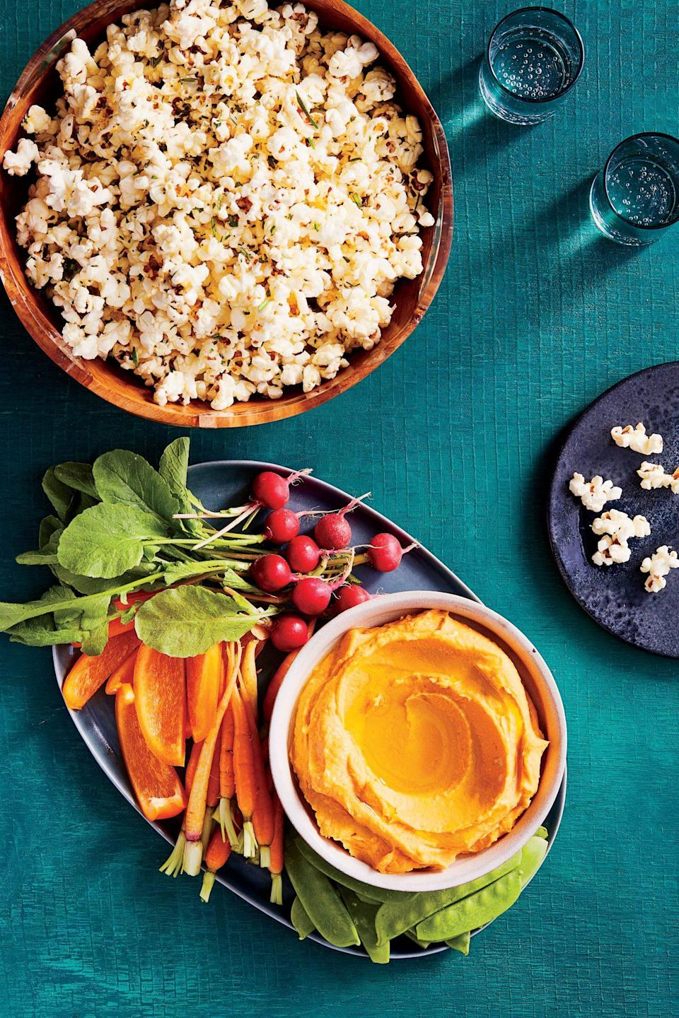 """<p><strong>Recipe: <a href=""""https://www.southernliving.com/recipes/roasted-sweet-potato-hummus-recipe"""" rel=""""nofollow noopener"""" target=""""_blank"""" data-ylk=""""slk:Roasted Sweet Potato Hummus"""" class=""""link rapid-noclick-resp"""">Roasted Sweet Potato Hummus</a></strong></p> <p>Sweet potatoes come together with chickpeas to give this hummus a vibrant color and sweeter flavor. Complete your appetizer by serving with your favorite vegetables and pita chips.</p>"""
