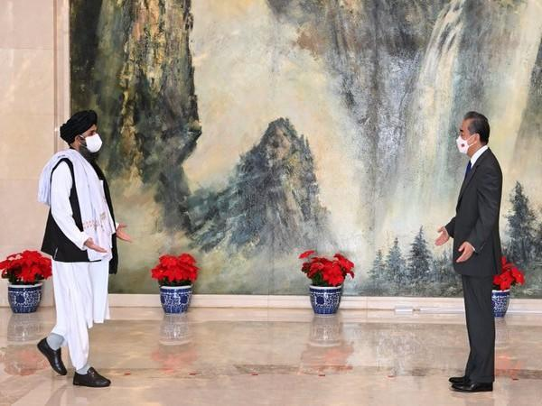 Chinese foreign minister Wang Yi meets with Head of the Afghan Taliban Political Commission Mullah Abdul Ghani Baradar
