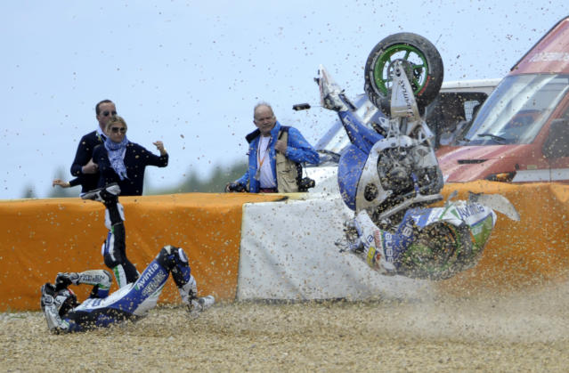 TOPSHOTS Avintia Blusens team's Colombian Yonny Hernandez crashes during the Moto GP race of the Portuguese Grand Prix in Estoril, outskirts of Lisbon, on May 6, 2012. Australian Casey Stoner won the race ahead Spanish Jorge Lorenzo and Dani Pedrosa. AFP PHOTO / MIGUEL RIOPAMIGUEL RIOPA/AFP/GettyImages