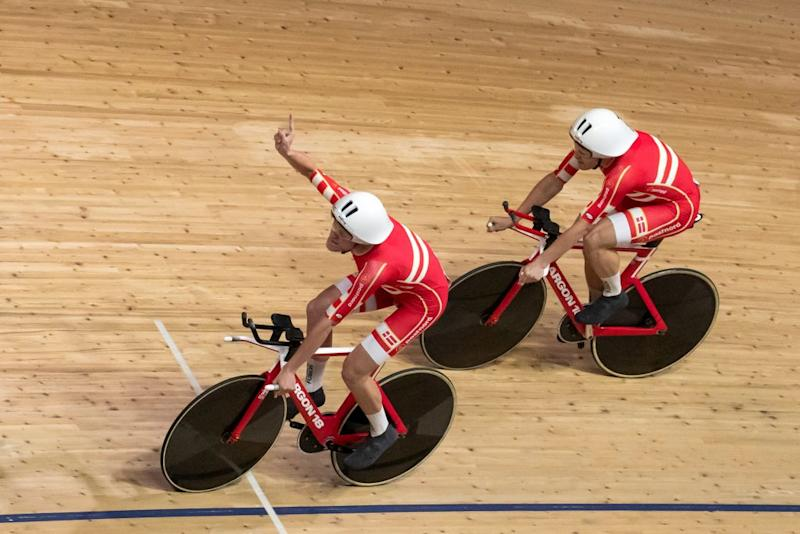 Members of Denmarks team celebrate after they set a new world record compete in the Mens Team Pursuit qualifying at the UCI track cycling World Championship in Berlin on February 26 2020 Photo by Odd ANDERSEN AFP Photo by ODD ANDERSENAFP via Getty Images