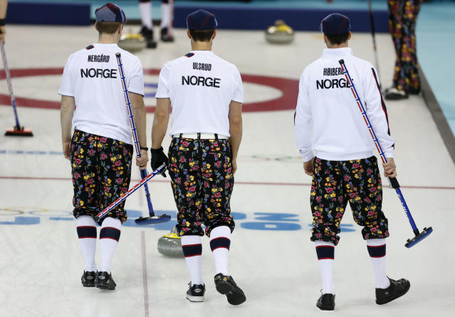 Norwegian curlers wear rose-painting knickers during curling training at the 2014 Winter Olympics, Saturday, Feb. 8, 2014, in Sochi, Russia. (AP Photo/Robert F. Bukaty)