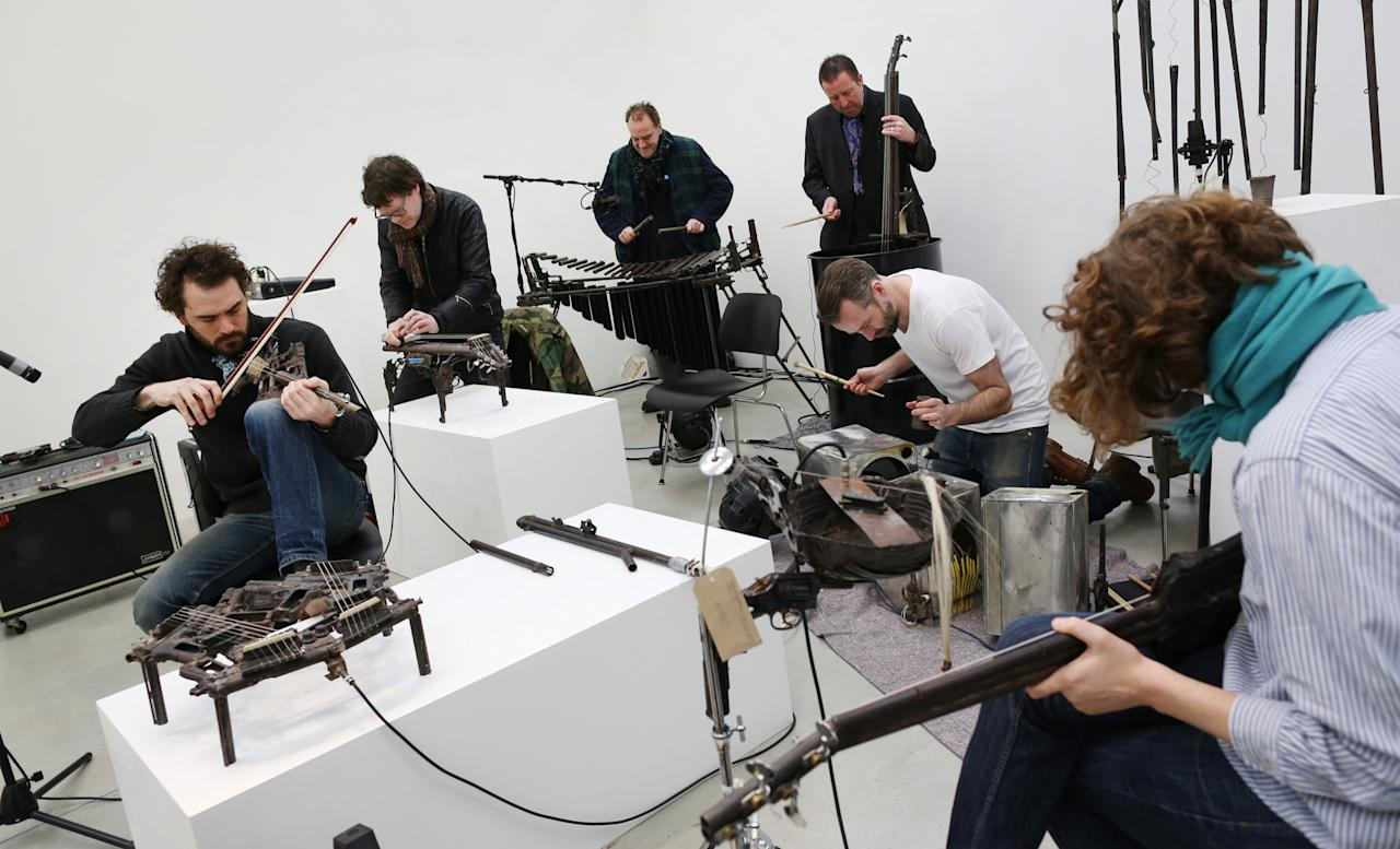 LONDON, ENGLAND - MARCH 26:  Musical instruments made from recycled gun parts are played  at the Lisson Gallery on March 26, 2013 in London, England.  Mexican artist Pedro Reyes received 6,700 destroyed weapons from the Mexican government from which he sculpted two groups of instruments. The first, a series titled Imagine, is an orchestra of fifty instruments, from flutes to string and percussion instruments, designed to be played live. The second, Disarm, is an installation of mechanical musical instruments, which can either be automated or played live by an individual operator using a laptop computer or midi keyboard.  (Photo by Peter Macdiarmid/Getty Images)