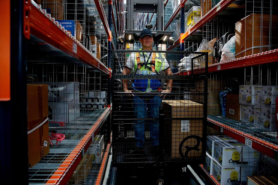 Employees at work during the visit by the French president to the Amazon factory in Boves, near Amiens, northern France on October 3, 2017. (Photo: YOAN VALAT/AFP via Getty Images)