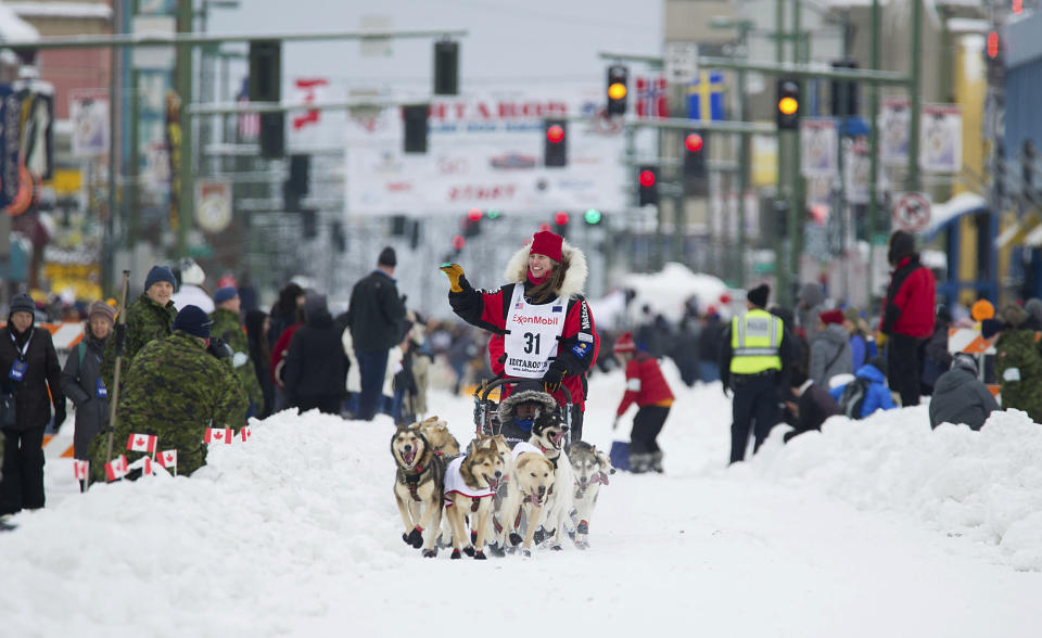 File - In this March 3, 2018, file photo, musher Aliy Zirkle runs her team during the ceremonial start of the Iditarod Trail Sled Dog Race in Anchorage, Alaska. The veteran musher is leading in Alaska's Iditarod Trail Sled Dog Race. She is seeking to become the first woman to win in nearly three decades. She was first to leave the Ophir checkpoint Wednesday, March 6, 2019, 432 miles into the race. (AP Photo/Michael Dinneen, File)