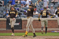 San Diego Padres' Fernando Tatis Jr., center, reacts as he crosses home plate after hitting a grand slam during the seventh inning of a baseball game against the New York Mets at Citi Field, Sunday, June 13, 2021, in New York. (AP Photo/Seth Wenig)