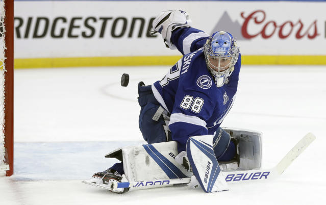 Tampa Bay Lightning goaltender Andrei Vasilevskiy (88) makes a save on a shot by the New Jersey Devils during the first period of Game 5 of an NHL first-round hockey playoff series Saturday, April 21, 2018, in Tampa, Fla. (AP Photo/Chris O'Meara)
