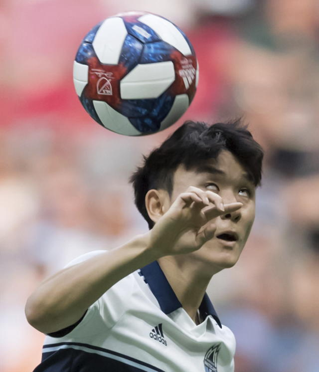 Vancouver Whitecaps' Inbeom Hwang gets his head on the ball during the first half of an MLS soccer game against the San Jose Earthquakes, Saturday, July 20, 2019 in Vancouver, British Columbia. (Darryl Dyck/The Canadian Press via AP)