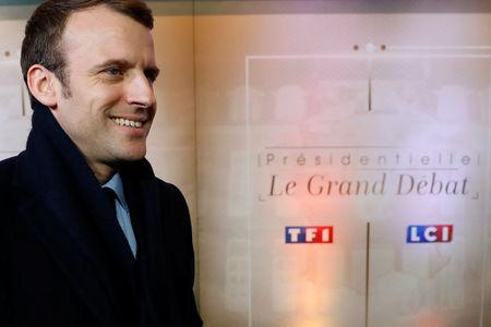 Emmanuel Macron, head of the political movement En Marche !, or Onwards !, and candidate for the 2017 presidential election, arrives for a debate organised by French private TV channel TF1 in Aubervilliers